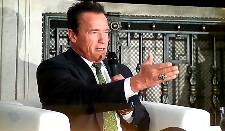 Arnold with a definitive hand gesture