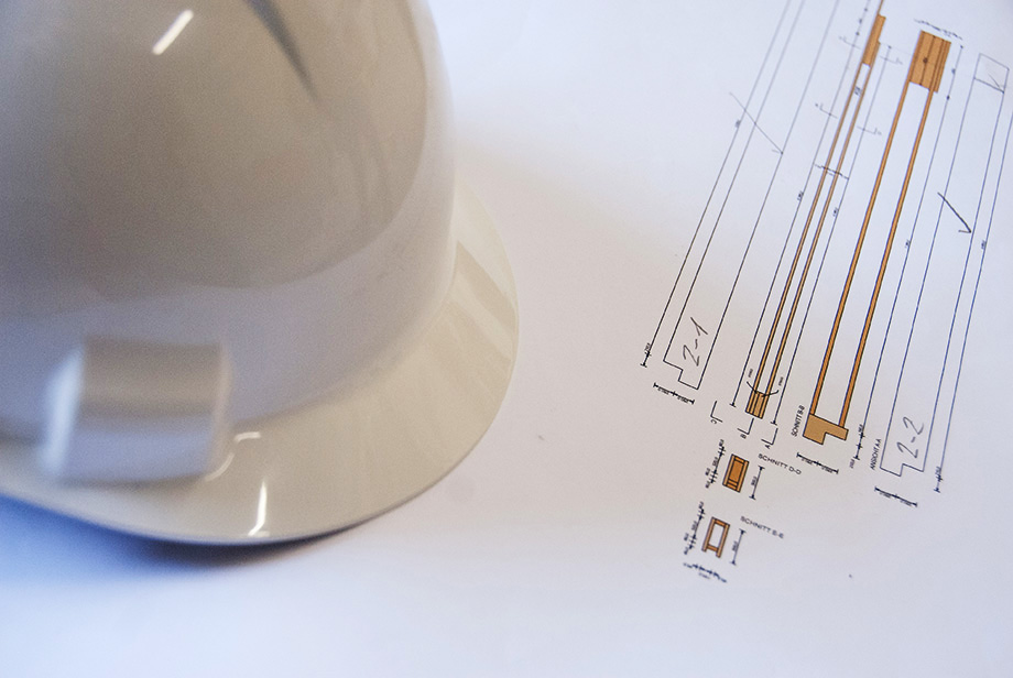 Close-Up of a helmet lying on top of technical drawings