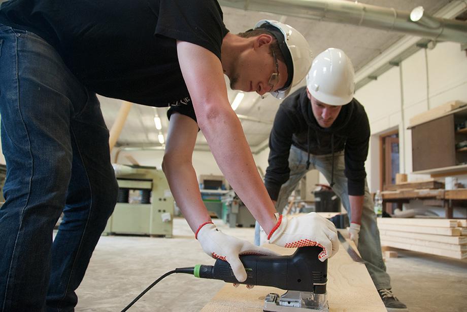 Thomas cutting wood with a jigsaw