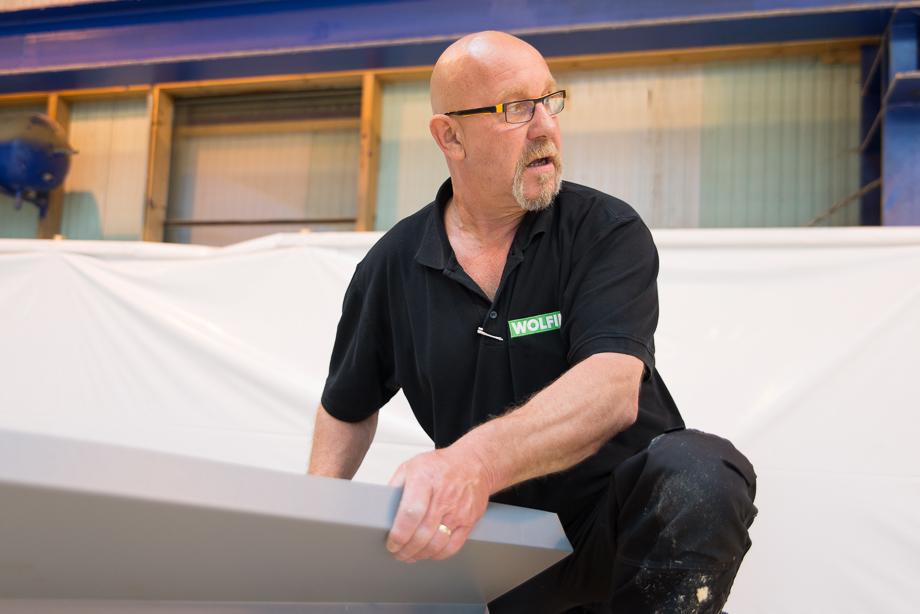 Wolfin employee installing the insulation