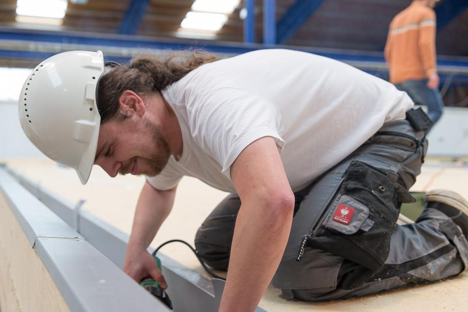 Benedict installing insulation