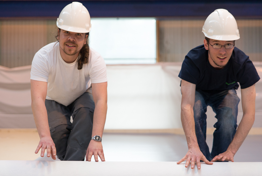 Benedict and Philipp unrolling layers of insulation