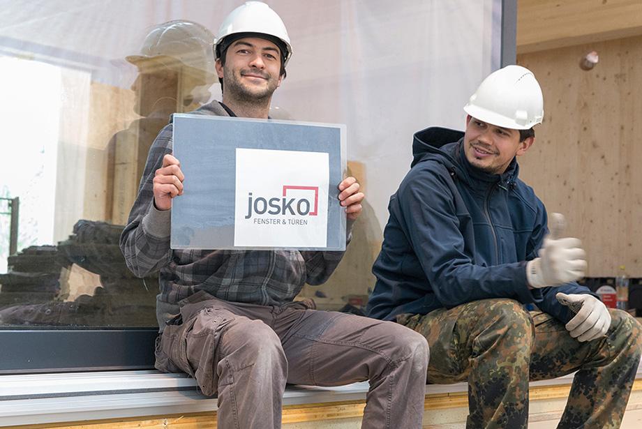 Johannes holding up a Josko Logo. He seems happy