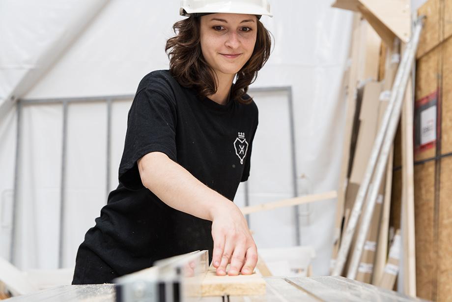 Kathi cutting some wood