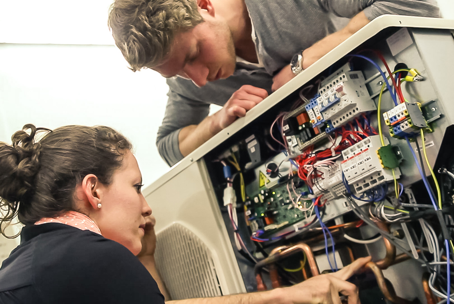 Philipp and Sabrina tinkering with the electronics of our house