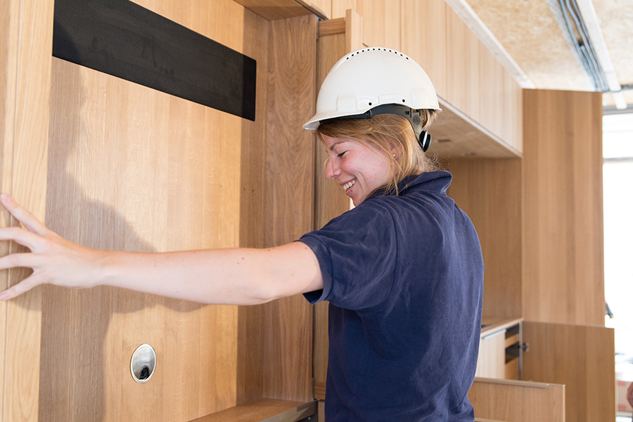 Sigrid having fun installing the kitchen