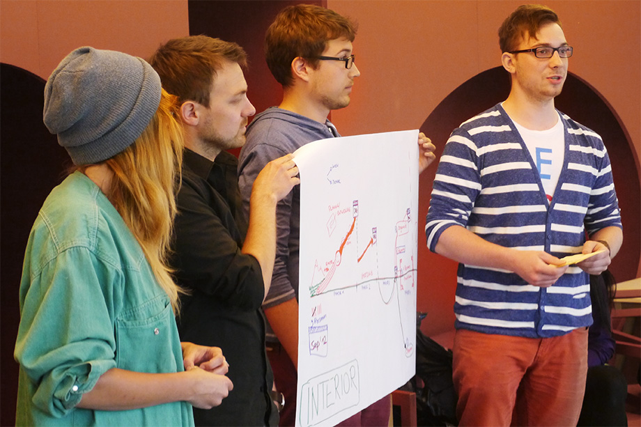 Decathletes presenting a poster during a coaching class