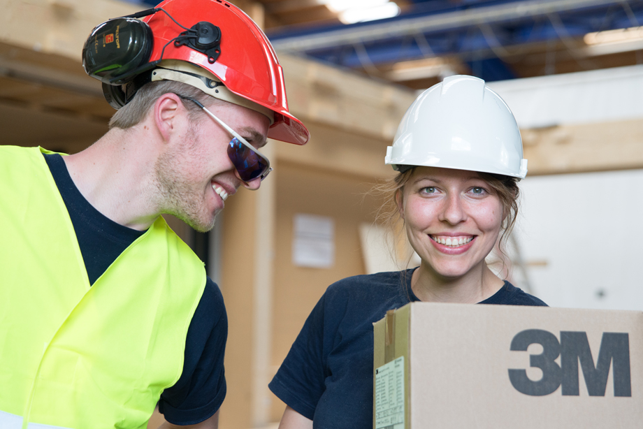 Phil and Edith smiling while wearing the helmets from company 3M