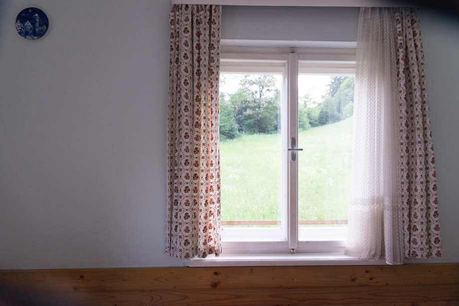 window of a rural house with vintage curtains