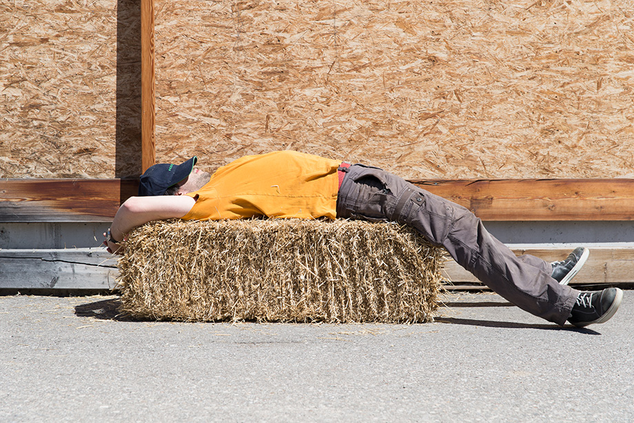 Decathlete sleeping on a stack of hay