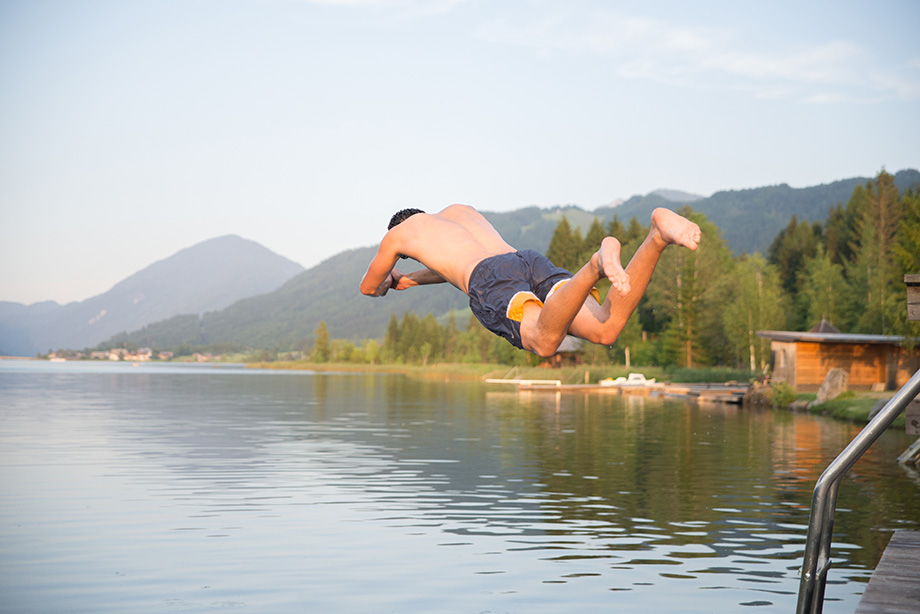 Decathlete jumping in the lake