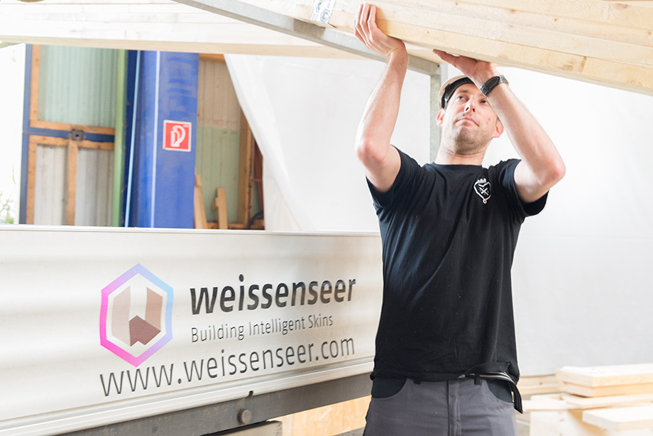 Roman lifting a beam
