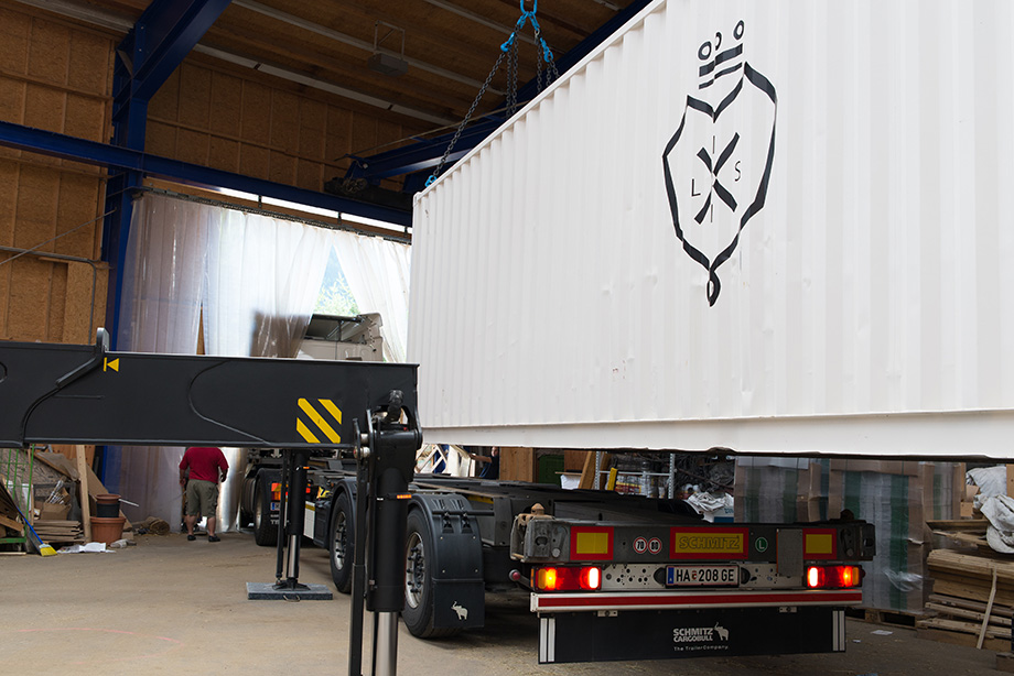 The LISI container being loaded onto a truck