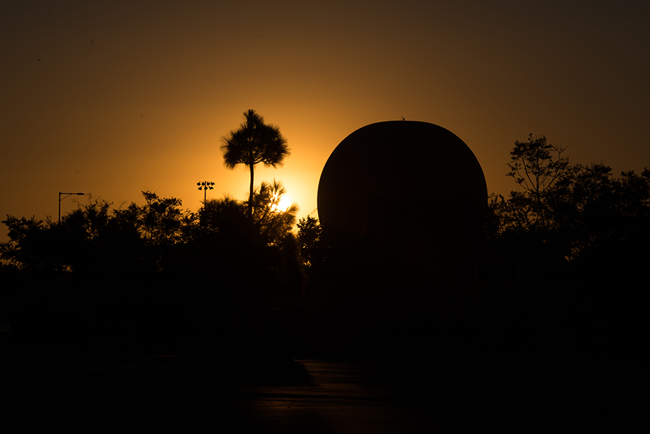 A beautiful sunset with the silhouette of palm trees and the hot air balloon.