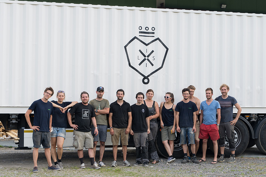 Group picture with a container in the background