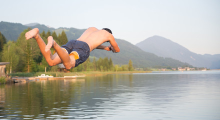 Cover Photo of a decathlete jumping in a lake
