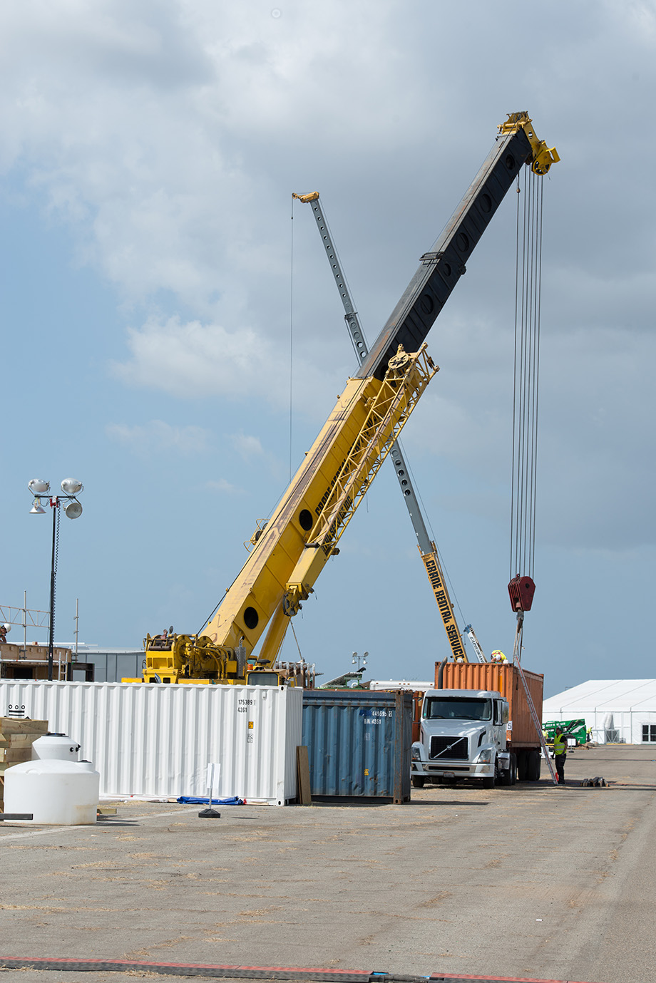 Crane lifting off the container.