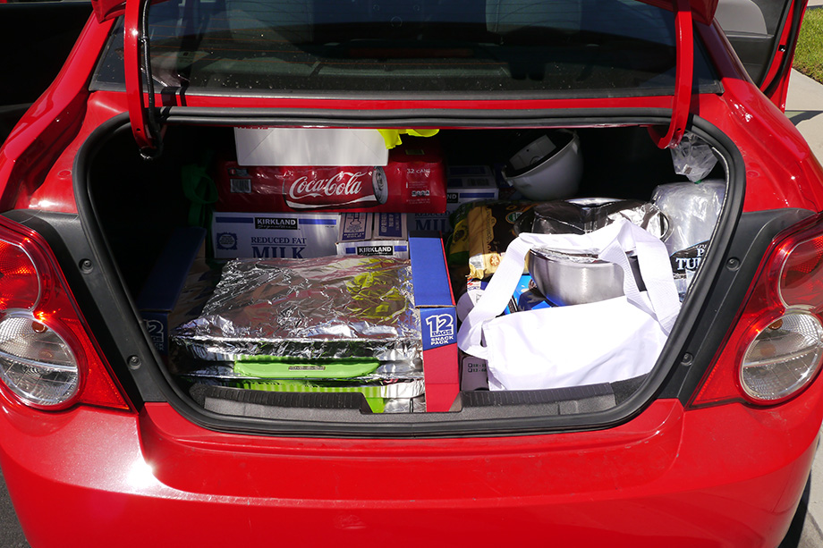 Filling the cars trunk with delicious food.