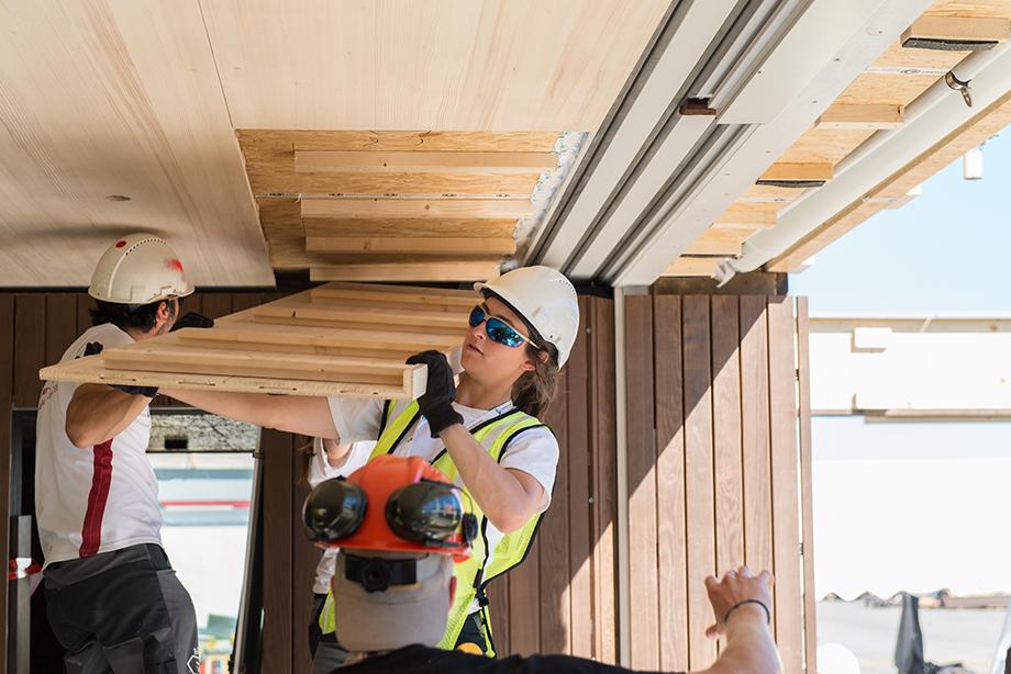 Kathi lifting the ceiling panels