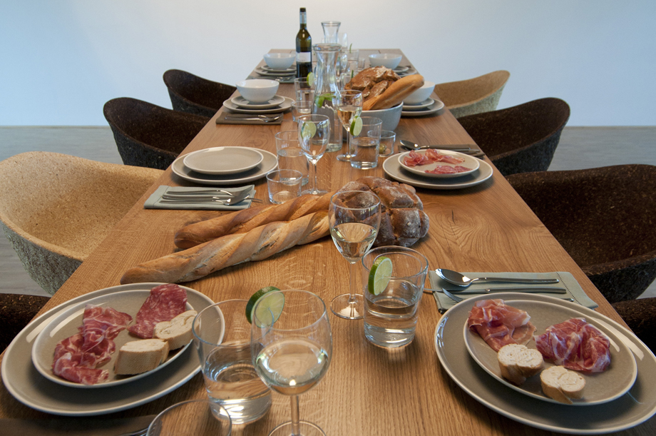 A table full with food. Bread and prosciutto.