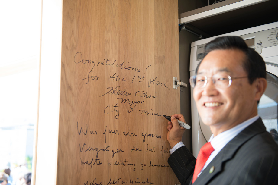 Mayor Choi signs on the inside of our kitchen cabinet doors.