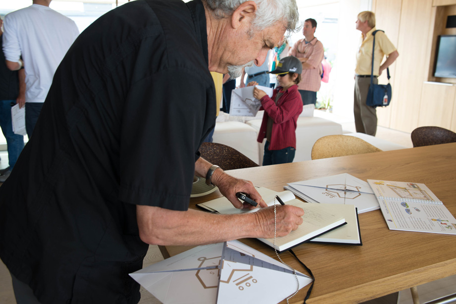 Raymond Neutra, son of famous architect Richard Neutra signing the guest book.
