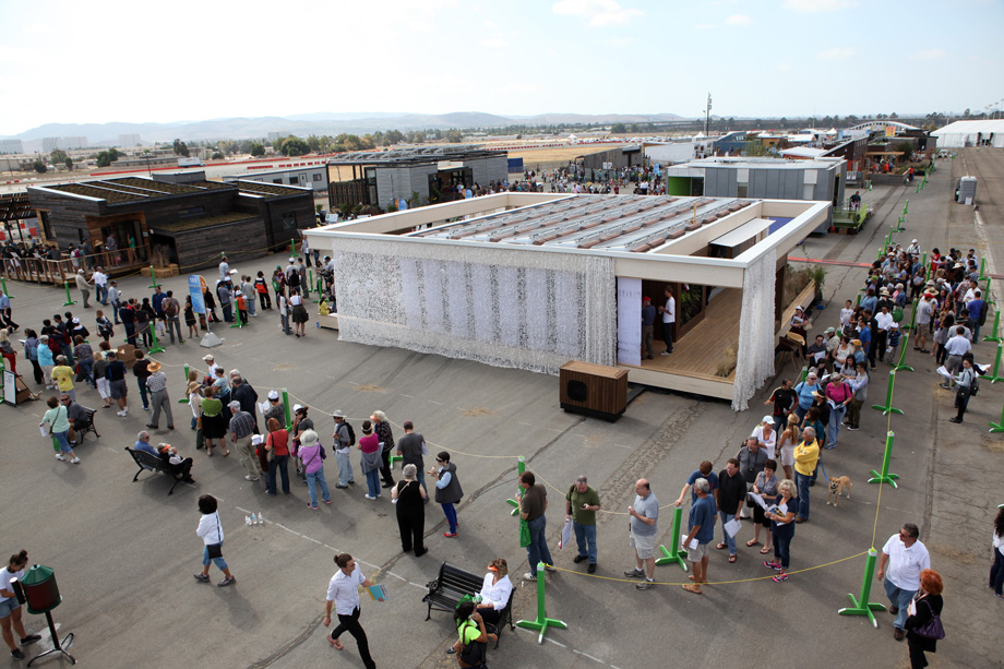 Visitors line up to tour the Team Austria house, built by students from Vienna Institute of Technology, after it came in first place overall at the U.S. Department of Energy Solar Decathlon 2013 at the Orange County Great Park in Irvine, Calif. on October 13, 2013 (Credit: Stefano Paltera/U.S. Department of Energy Solar Decathlon)