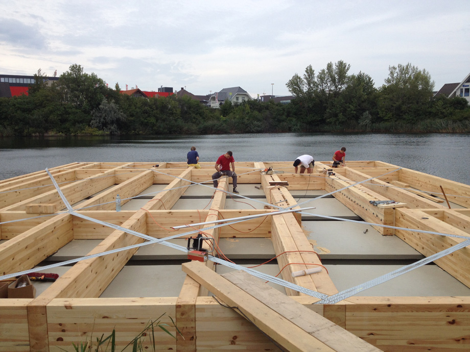 The construction placed on top of the pontoons is made of wood.